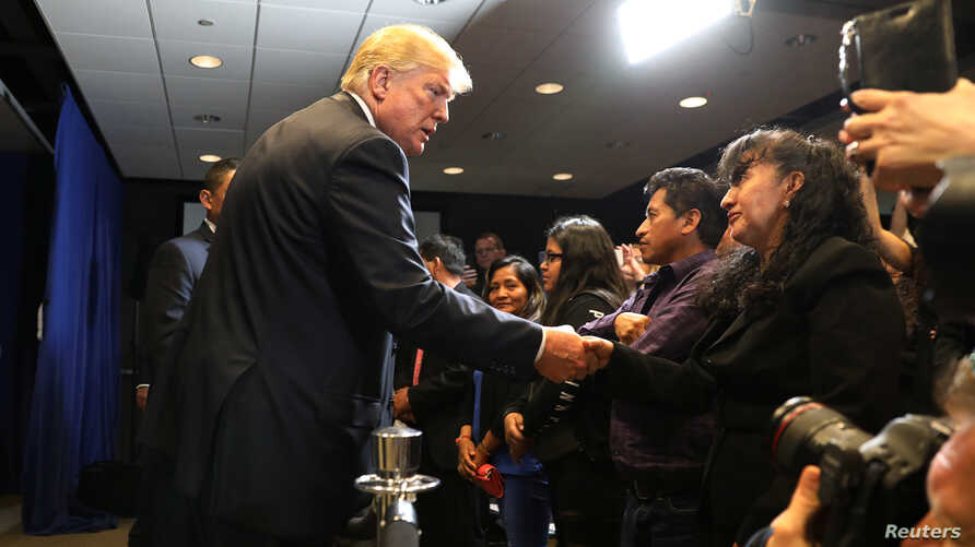 U.S. President Donald Trump greets families of those whose slayings have been attributed to MS-13 gang members, after a round-table discussion on immigration and the gang MS-13 at the Morrelly Homeland Security Center in Bethpage, N.Y., May 23, 2018.