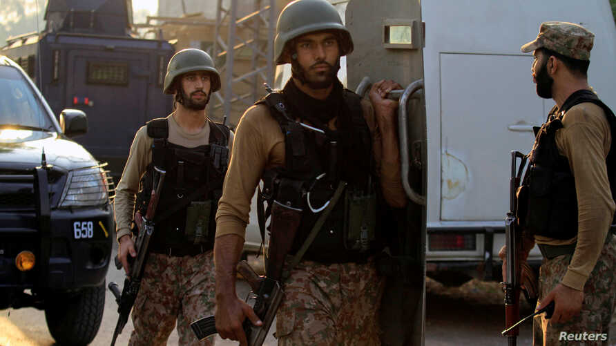 Soldiers return to the staging area after participating in a security operation on the outskirts of Peshawar, Pakistan June 24, 2017.