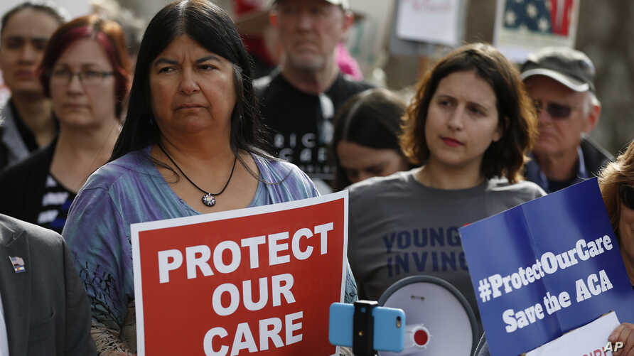 State Sen. Dr. Irene Aguilar, D-Denver, left, stands with activist Christina Postolowski, of the group Young Invincibles, as supporters of the Affordable Care Act who are also opponents of Colorado's GOP-led plan to undo Colorado's state-run insuranc...