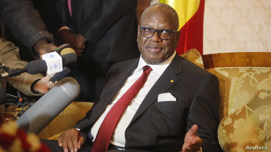 FILE: Mali's President Ibrahim Boubacar Keita announced a cease-fire Friday. He's shown at a press conference Jan. 18, 2014.