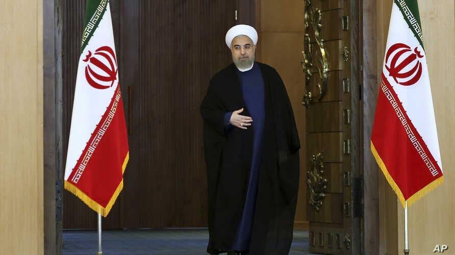 Iran's President Hassan Rouhani arrives for an address to the nation after a nuclear agreement was announced in Vienna, in Tehran, Iran, July 14, 2015.