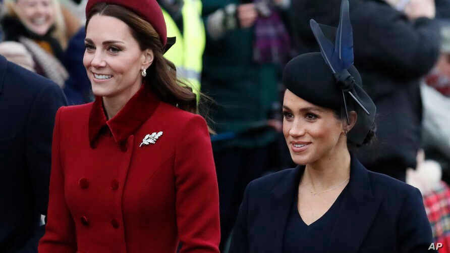 FILE -Britain's Kate, Duchess of Cambridge (L) and Meghan, Duchess of Sussex arrive to attend the Christmas day service at St Mary Magdalene Church in Sandringham in Norfolk, England, Dec. 25, 2018.