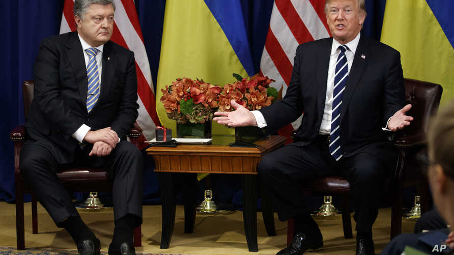 President Donald Trump, right, meets with Ukraine's President Petro Poroshenko at the Palace Hotel during the United Nations General Assembly, Sept. 21, 2017, in New York.
