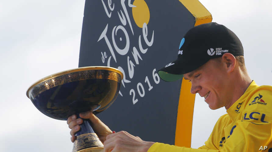 2016 Tour de France winner Chris Froome of Britain celebrates on the podium after the twenty-first and last stage of the Tour de France cycling race in Paris, France, Sunday, July 24, 2016.