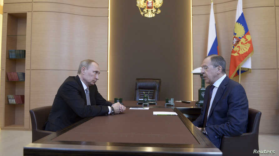 Russian President Vladimir Putin (left) meets with Foreign Minister Sergei Lavrov in Sochi, March 10, 2014.