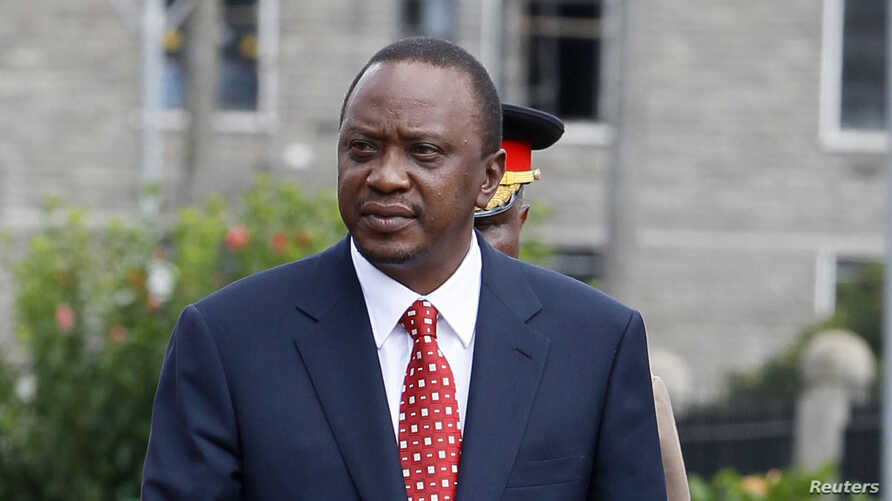 Kenya's President Uhuru Kenyatta prepares to inspect a guard of honor before the opening of the 11th Parliament at the National Assembly Chamber in Nairobi, April 16, 2013.