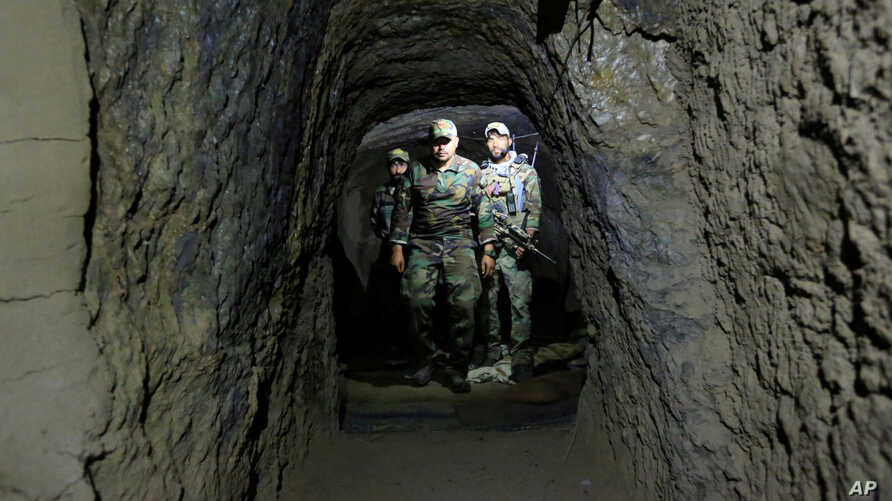 Afghan Special Forces inspect inside a cave which was used by suspected Islamic State militants at the site where a MOAB, or ''mother of all bombs'', struck the Achin district of the eastern province of Nangarhar, Afghanistan April 23, 2017.