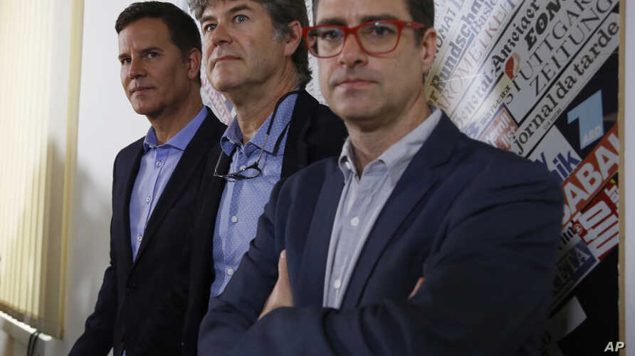 From left, Juan Carlos Cruz, James Hamilton and Jose Andres Murillo meet reporters at the foreign press association in Rome, May 2, 2018. The three whistle-blowers of Chile's sex abuse scandal are urging Pope Francis to transform his apology for havi
