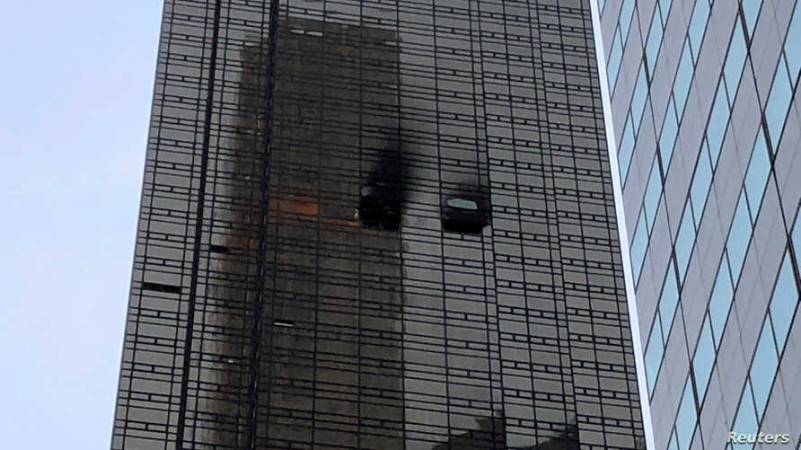 A residential unit's exterior is pictured following a fire at Trump Tower in the Manhattan borough of New York City, April 7, 2018.
