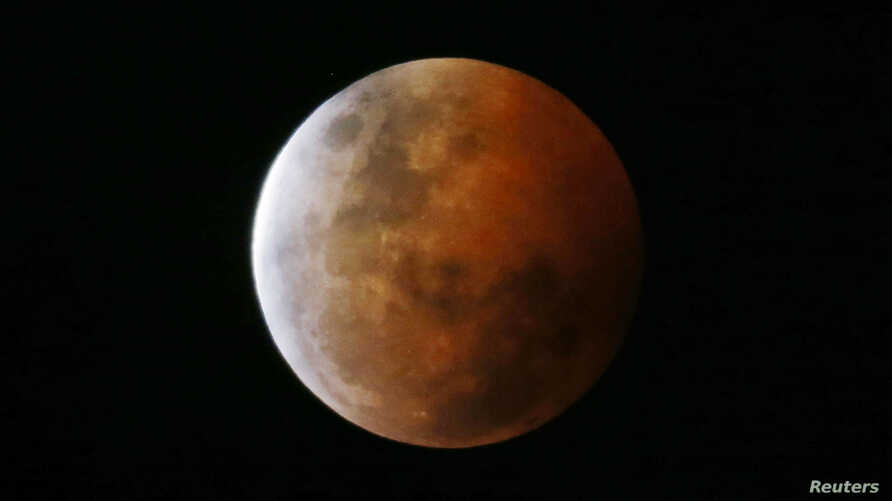 "A total lunar eclipse, also known as a ""blood moon,"" is pictured from Gosford, north of Sydney, Oct. 8, 2014."