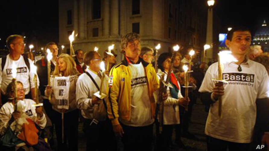 Demonstrators against the Vatican's handling of priest sex abuse cases, hold candles during a protest near St. Peter's square, Sunday, Oct. 31, 2010.
