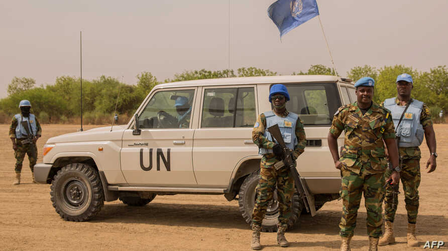 Ghanaian peacekeepers of the United Nations Mission in South Sudan patrol on March 7, 2018 in Leer, where famine has been declared since February 2017.