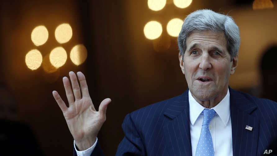 U.S. Secretary of State John Kerry talks to reporters as he leaves his hotel on the way to Mass at the St. Stephen's Cathedral in Vienna, Austria, July 12, 2015.