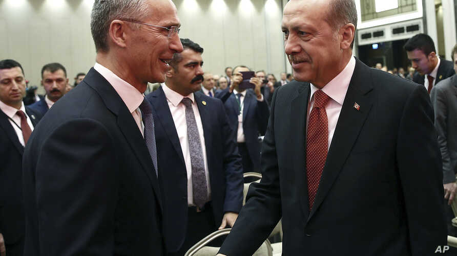 Turkey's President Recep Tayyip Erdogan, right, and NATO Secretary-General Jens Stoltenberg shake hands as they attend a NATO parliamentary assembly meeting in Istanbul, Nov. 21, 2016.
