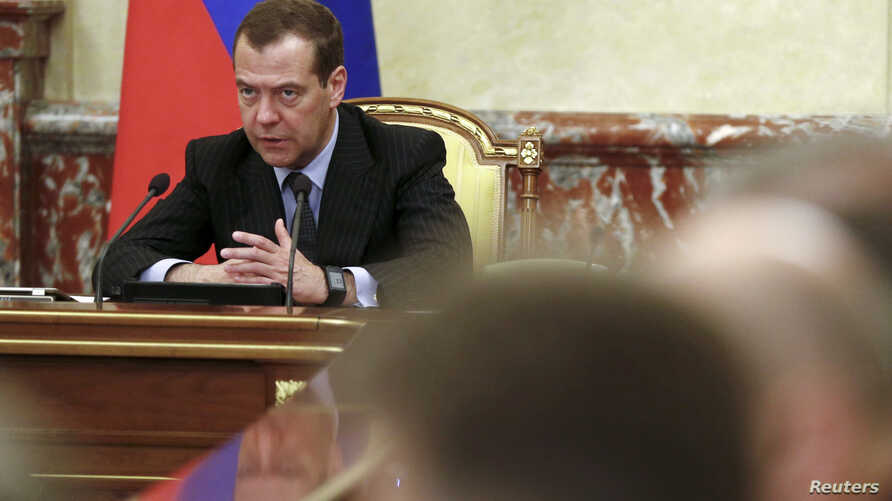 "FILE - Russian Prime Minister Dmitry Medvedev chairs a meeting with members of the government in Moscow, Russia, June 29, 2017. On Thursday, Medvedev announced sanctions against Ukrainian individuals and entities ""to counter Ukraine's unfriendly acti"