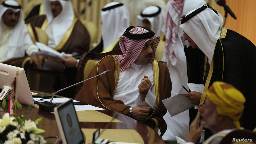 """Qatar's Foreign Minister Khalid bin Mohamed Al-Attiyah (L) attends  Gulf Cooperation Council (GCC) meeting in Riyadh June 2, 2014. Gulf Arab foreign ministers have called for Iran to """"strengthen the security and stability"""" of the Gulf region by enter..."""