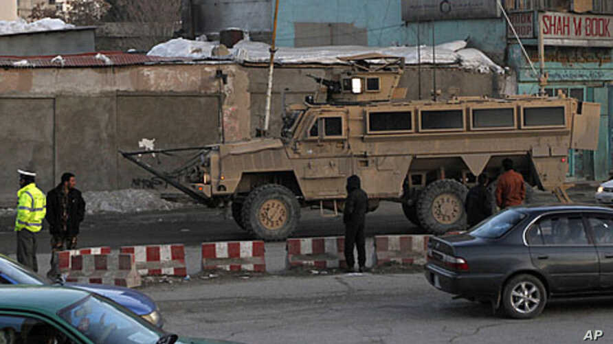 A U.S. military vehicle drives on the road leading to the Afghan Interior Ministry in Kabulو February 25, 2012.