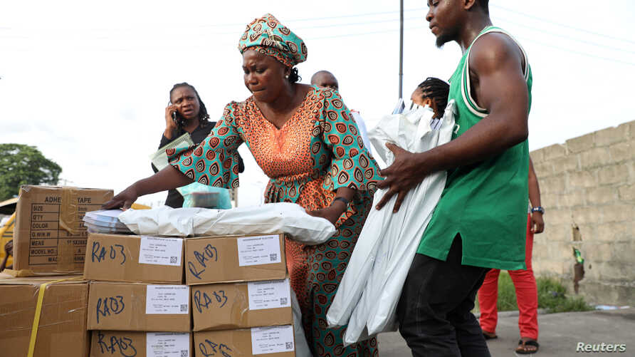 Independent National Electoral Commission ad hoc workers sort election materials in Lagos, Nigeria, March 8, 2019.