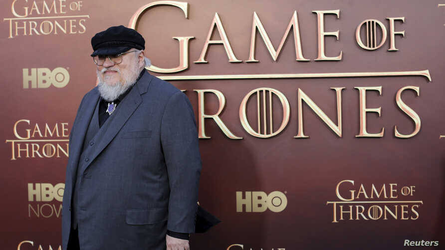 """FILE - Co-executive producer George R.R. Martin arrives for the season premiere of HBO's """"Game of Thrones"""" in San Francisco, California."""