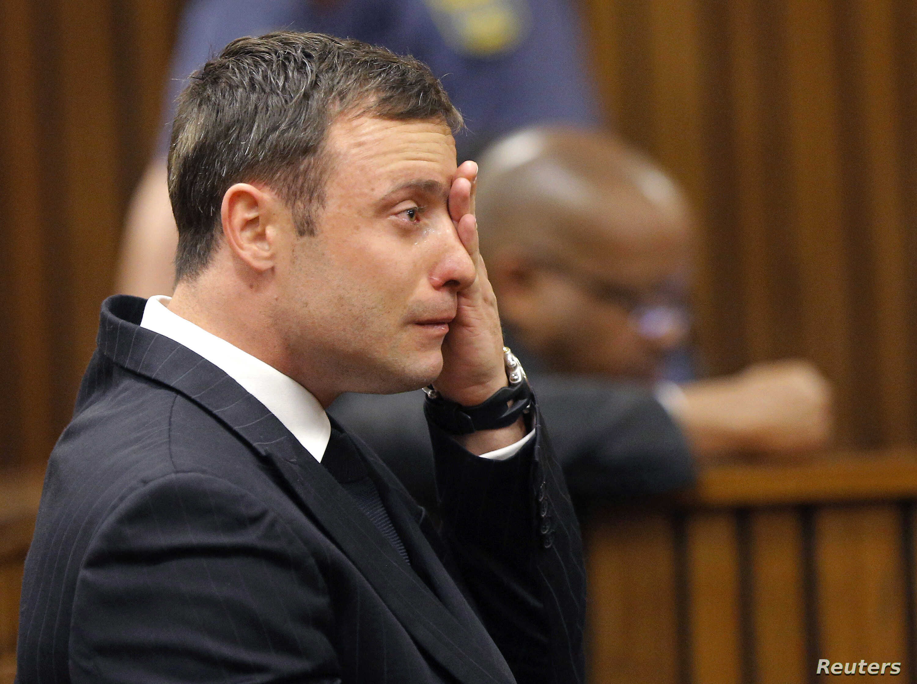 """Olympic and Paralympic track star Oscar Pistorius reacts as he listens to Judge Thokozile Masipa's judgement at the North Gauteng High Court in Pretoria, September 11, 2014. Masipa said on Thursday there was """"some doubt"""" a woman screamed on the night"""