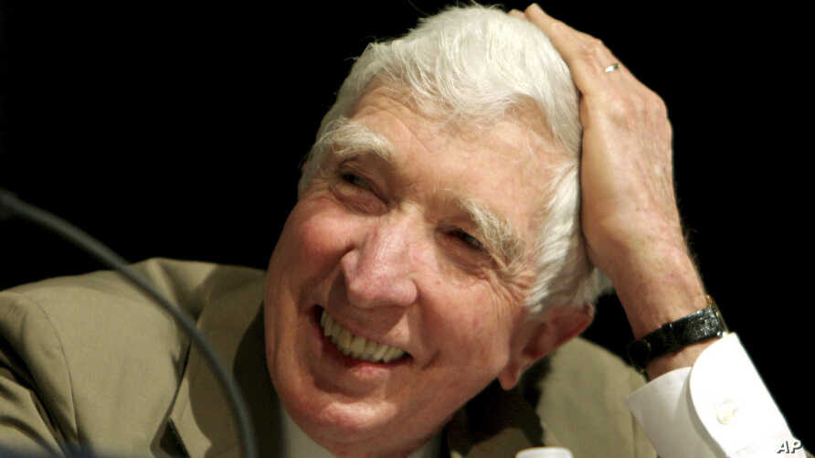 FILE - Author John Updike takes part in a panel discussion at BookExpo America 2006 in Washington, May 20, 2006.