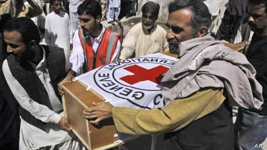 Pakistani hospital staff and rescue workers carry the coffin of British Red Cross worker Khalil Rasjed Dale to an ambulance, from a hospital in Quetta, Pakistan, April 30, 2012.