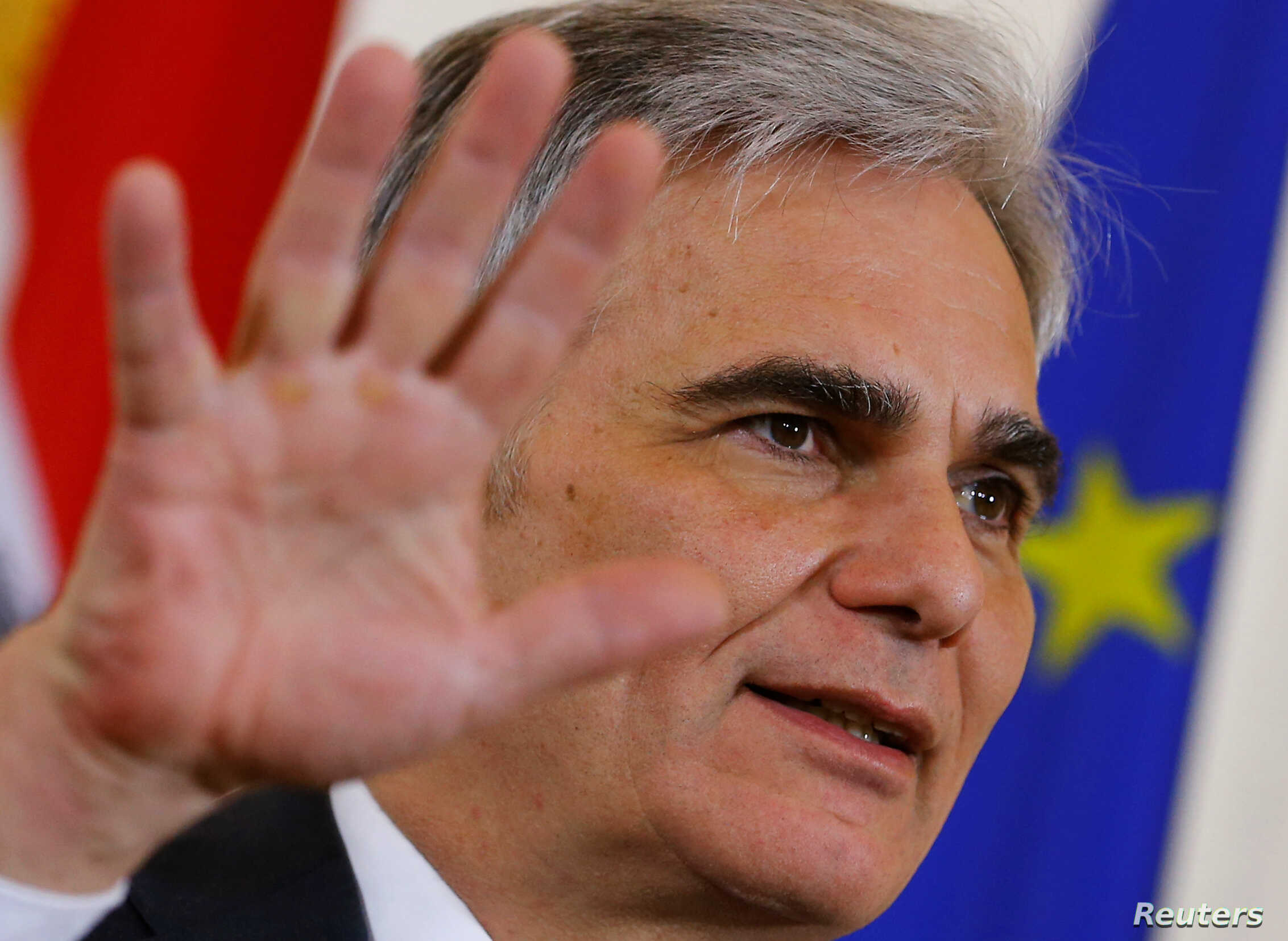 Austrian Chancellor Werner Faymann addresses a news conference after a cabinet meeting in Vienna, Feb. 16, 2016.