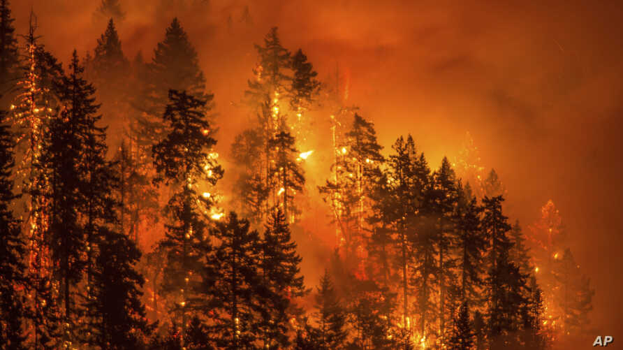FILE - This photo provided by KATU-TV shows a wildfire as seen from near Stevenson, Washington, across the Columbia River, burning in the Columbia River Gorge above Cascade Locks, Oregon, Sept. 4, 2017.