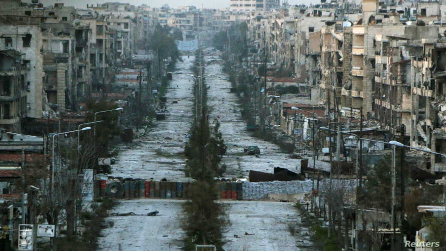 A general view shows a damaged street with sandbags used as barriers in Aleppo's Saif al-Dawla district, Syria, March 6, 2015.