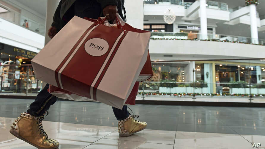 FILE - People shop at the Pentagon City Mall in Arlington, Virginia, Dec. 22, 2017. On March 1, 2018, the U.S. Commerce Department issued its January report on consumer spending.