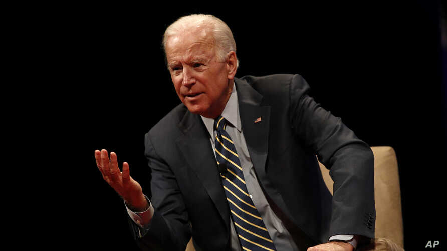 Former Vice President Joe Biden participates in a discussion on bridging political and partisan divides with Ohio Gov. John Kasich at the University of Delaware, Newark, Del., Oct. 17, 2017.