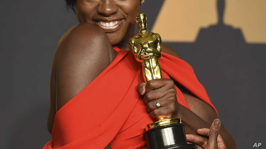 Viola Davis poses in the press room at the Oscars on Sunday, Feb. 26, 2017, at the Dolby Theatre in Los Angeles.