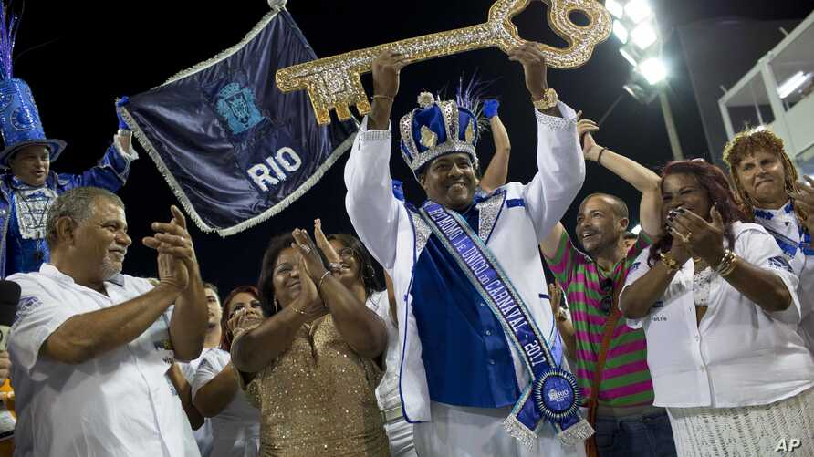 Carnival King Momo, Fabio Damiao dos Santos Antunes, holds up the key to the city at a ceremony marking the official start of Carnival in Rio de Janeiro, Brazil, Feb. 24, 2017.