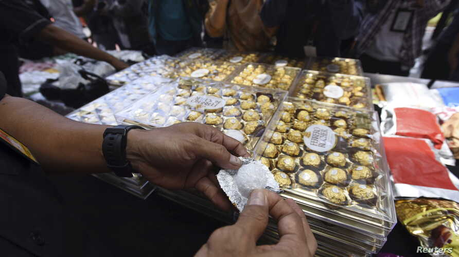 Police show crystal methamphetamine packaged as boxes of chocolate to journalists following a drug trafficking operation which netted 202 billion rupiah (approx $15.4 million USD) worth of various narcotics at police headquarters, Jakarta, Indonesia,
