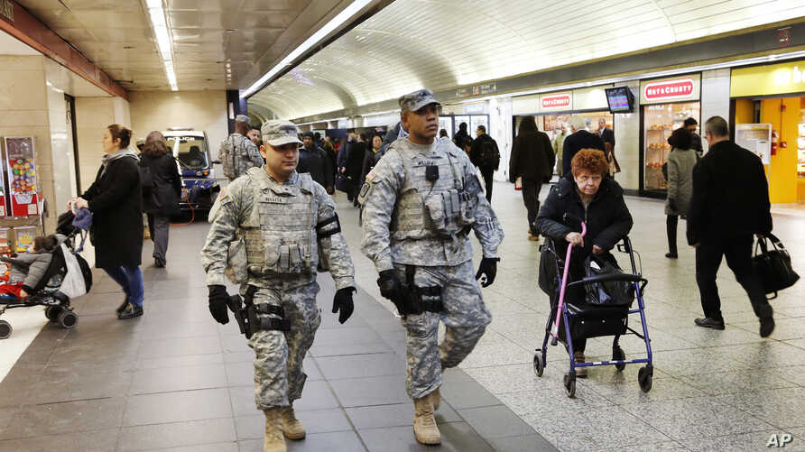 Members of the New York National Guard patrol Penn Station, March 22, 2016, in New York.