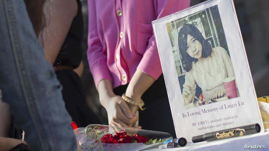 A photo of Lingzi Lu, a Chinese graduate student studying mathematics and statistics at Boston University, is seen outside the Marsh Chapel before a memorial for the third fatality of the Boston Marathon bombings in Boston, April 17, 2013.