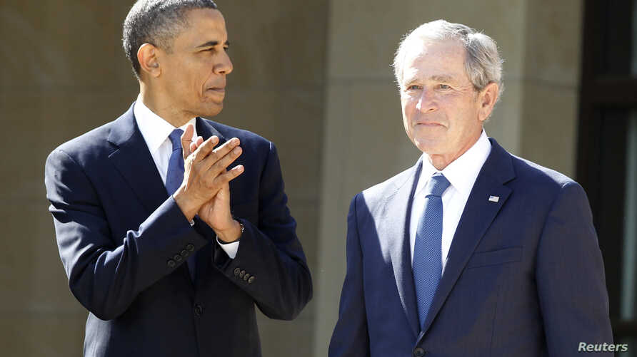 U.S. President Barack Obama applauds as former president George W. Bush arrives on stage at the dedication ceremony for the George W. Bush Presidential Center in Dallas, April 25, 2013.
