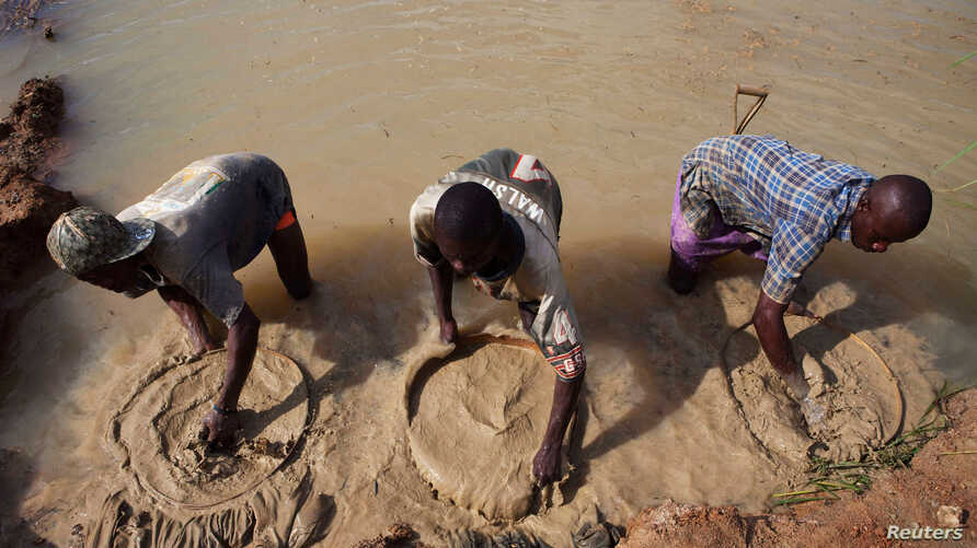 FILE - Artisanal miners pan for diamonds, which fuelled the 1991-2002 civil war, in the town of Koidu in eastern Sierra Leone, Apr. 21, 2012.