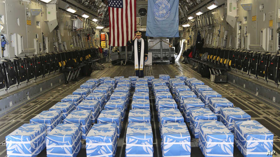 FILE - United Nations Command Chaplain U.S. Army Col. Sam Lee performs a blessing of sacrifice and remembrance on the 55 cases of remains believed to be U.S. servicemen killed during the Korean War and returned by North Korea at Osan Air Base in Pyeo