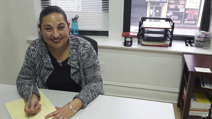 """Esperanza Villalobos, a """"community navigator,"""" works at her office at The Resurrection Project in Chicago, Illinois, Dec. 16, 2016. Villalobos helps immigrants who might need legal services to avoid deportation or learn about their legal rights."""