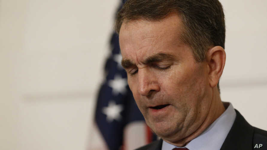 Virginia Gov. Ralph Northam pauses during a news conference in the Governor's Mansion at the Capitol in Richmond, Feb. 2, 2019. Northam is under fire for a racially insensitive photo that appeared in his college yearbook.