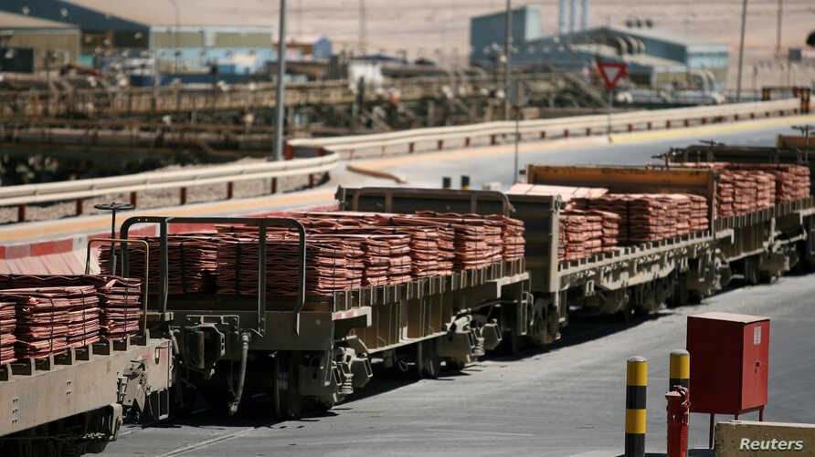 FILE - A train loaded with sheets of copper cathode at the copper cathode plant, is seen at BHP Billiton's Escondida, the world's biggest copper mine, in Antofagasta, northern Chile.