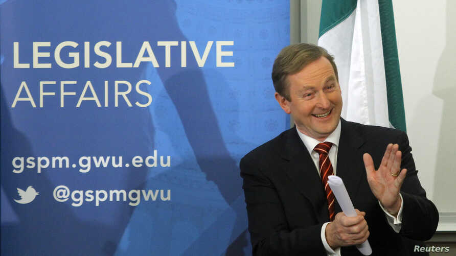 FILE - Irish Prime Minister Enda Kenny applauds his wife, Fionnuala O'Kelly (not pictured), prior to his speech at the George Washington University's Graduate School of Political Management in Washington, March 18, 2013. The prime minister is the foc