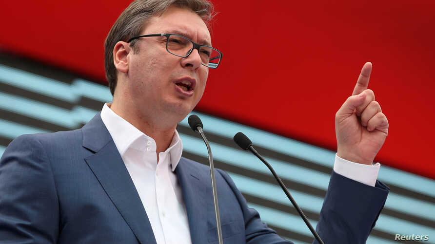 FILE - Serbian Prime Minister and President-elect Aleksandar Vucic speaks during a rally in Novi Sad, Serbia, March 18, 2017.
