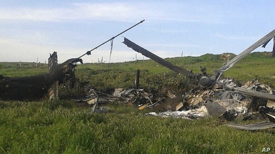 Remains of a downed Azerbaijani forces helicopter lies in a field in the separatist Nagorno-Karabakh region, April 2, 2016. Azerbaijan's Defense Ministry said one of its helicopters was shot down in heavy fighting Saturday between Armenian and Azerba