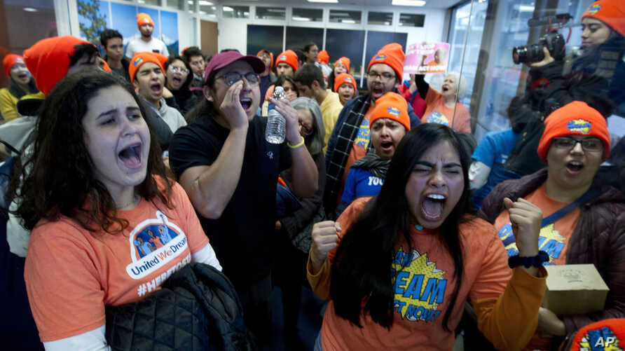 Demonstrators protest at the office of Sen. Dean Heller, R-Nev., in support of the Deferred Action for Childhood Arrivals  and Temporary Protected Status programs on Capitol Hill, Jan. 16, 2018, in Washington.