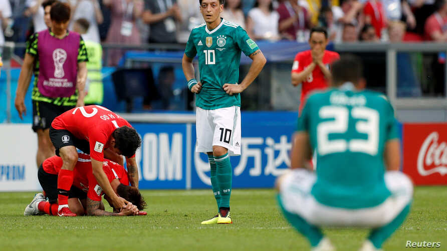 German midfielder Mesut Ozil reacts after a 2-0 loss to South Korea that eliminated Germany from the World Cup, June 27, 2018, in Kazan Arena in Kazan Russia.