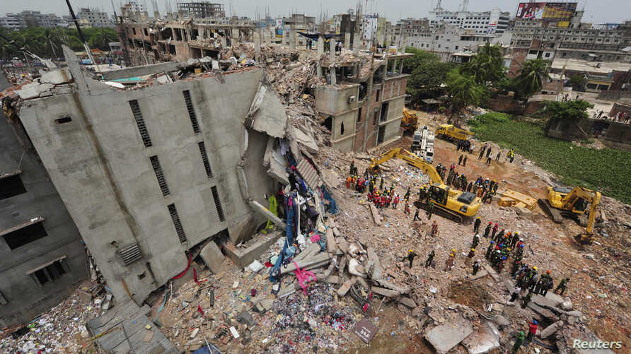 FILE - A view of rescue workers attempting to find survivors from the rubble of the collapsed Rana Plaza building in Savar April 30, 2013.