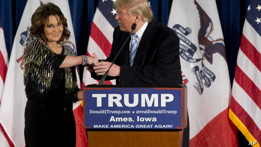 Former Alaska Gov. Sarah Palin, left, endorses Republican presidential candidate Donald Trump during a rally at the Iowa State University in Ames, Iowa, Jan. 19, 2016.