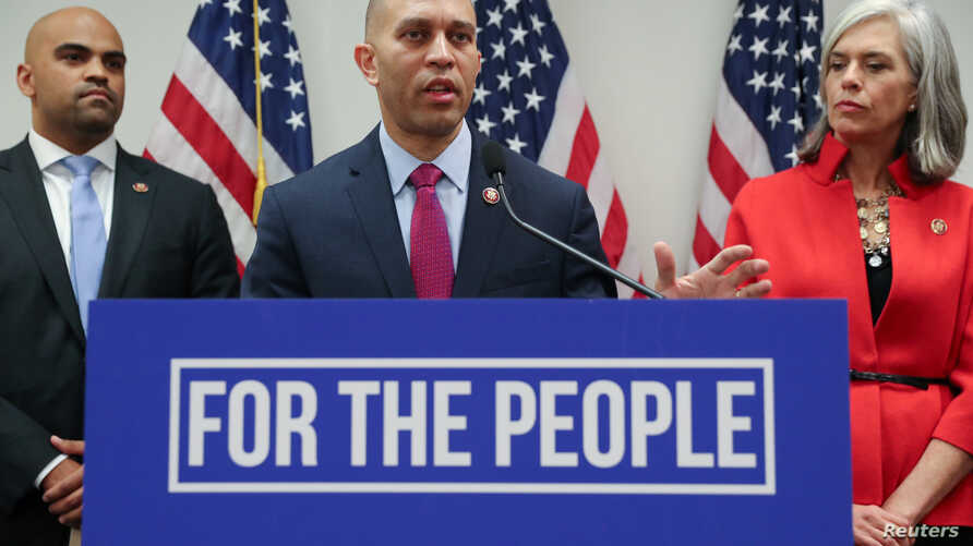 Democratic House caucus chairman U.S. Representative Hakeem Jeffries (D-NY), flanked by Representative Colin Allred (D-TX) and Representative Katherine Clark (D-MA), leads a news conference after a House Democratic party caucus meeting at the U.S. Ca